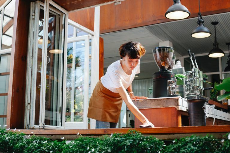 Waitress cleaning table at a restaurant